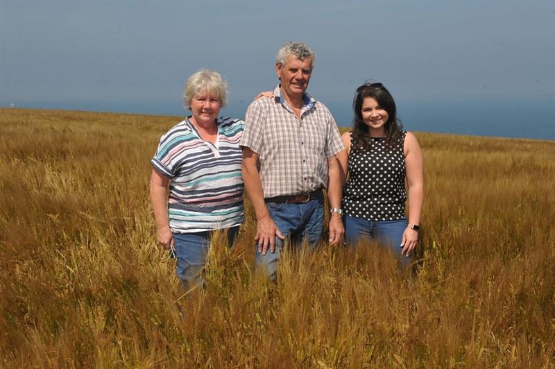 Edna, Andrew and Katie Davies in spring barley NFU Cymru_78055