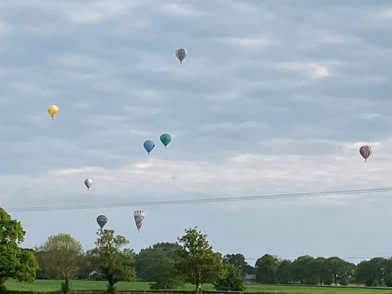 Hot air balloons flying over Richard Blackburn's farm_78878