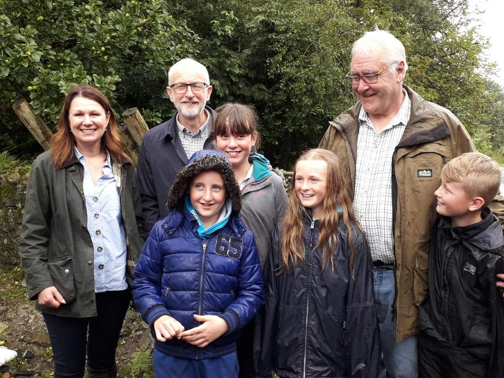 Will Cockbain, Jeremy Corbyn and Sue Hayman on farm in Cumbria