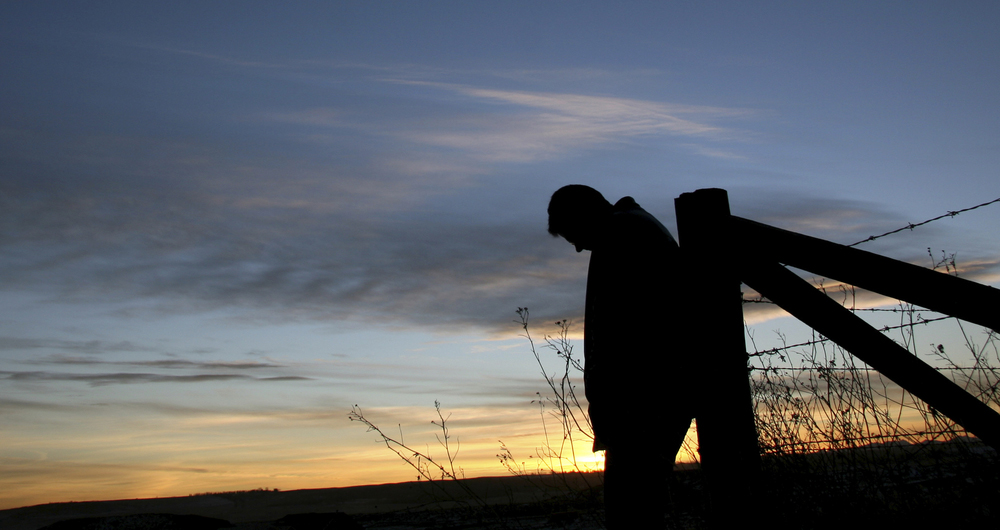 Silhouette of a farmer in a field