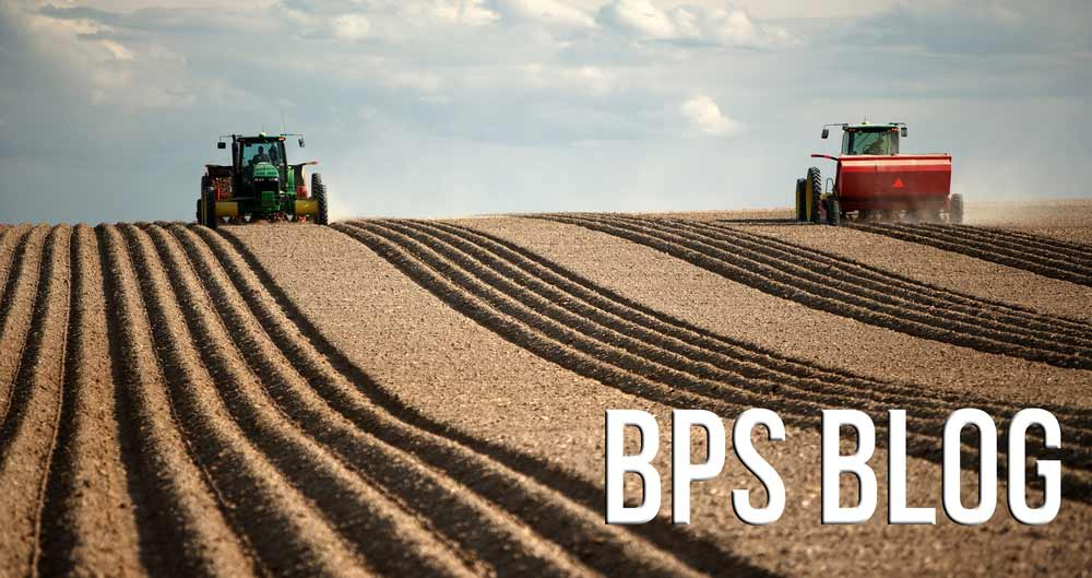 A BPS blog header image with tractors on ploughed field