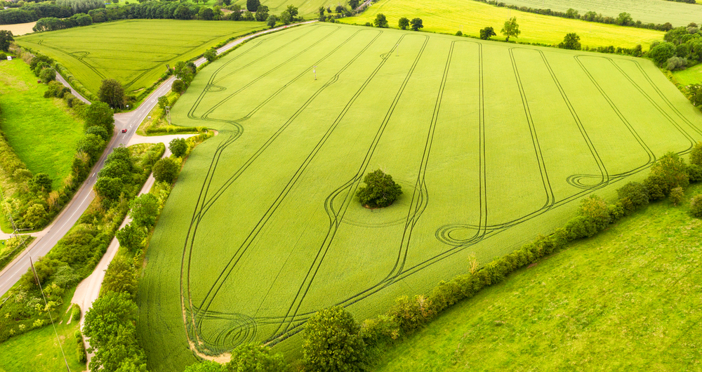 An aerial view of fields separated by traditional hedges and rural roads, in the East Midlands of England.