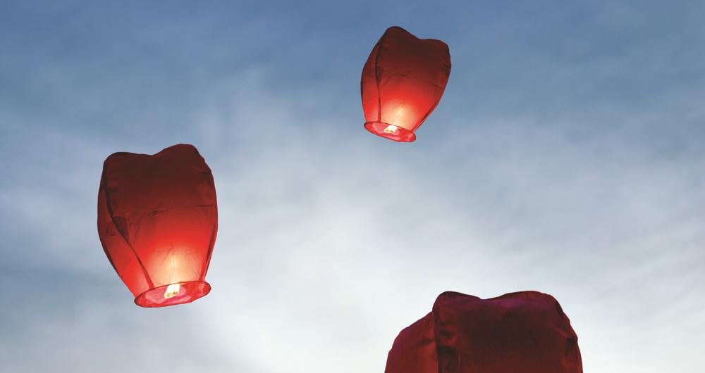 Three sky lanterns in the sky