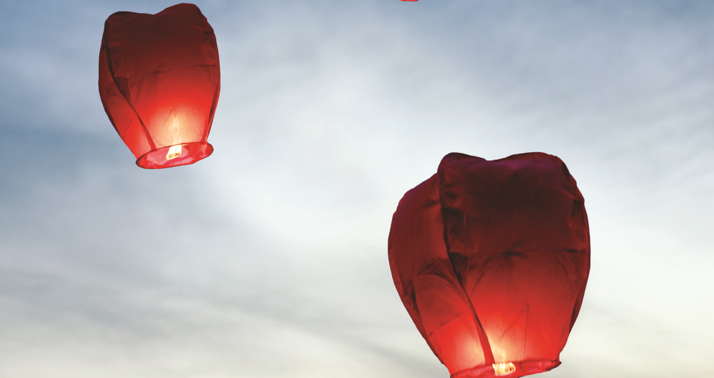 Three sky lanterns in the sky
