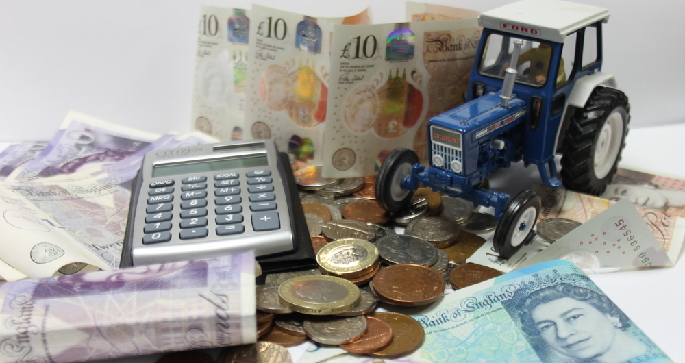 A tractor surrounded by money and a calculator