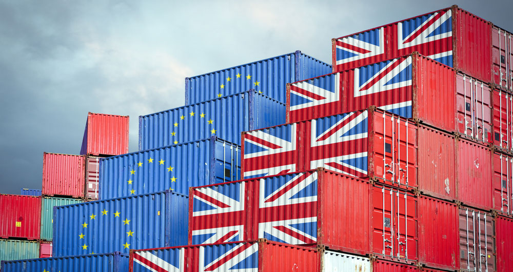 Shipping crates wih EU and UK flags