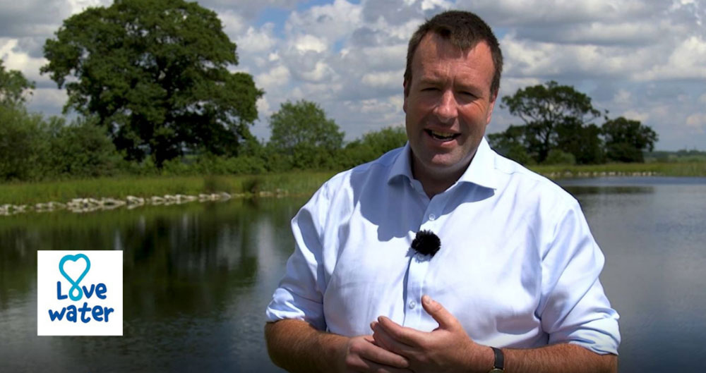 A photograph of NFU Deputy President Stuart Roberts against the backdrop of a reservoir