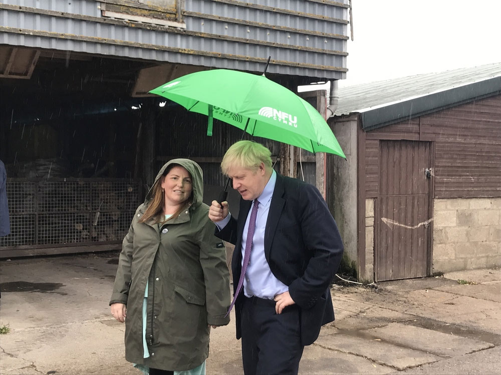 A photograph of Prime Minister Boris Johnson with Victoria Shervington-Jones at her family-owned egg business on the Gwent Levels, west of Newport, south Wales