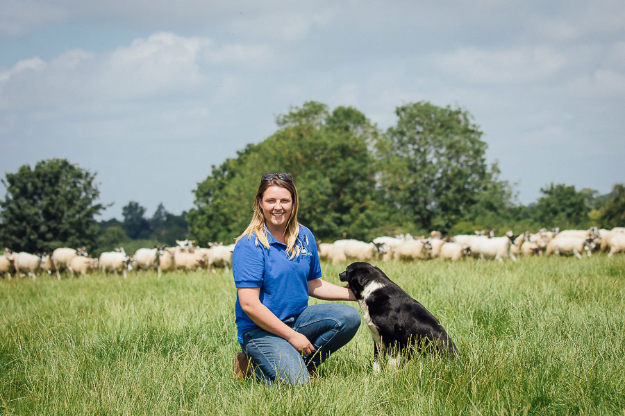 Charlie Beaty on farm with her sheap dog and stock