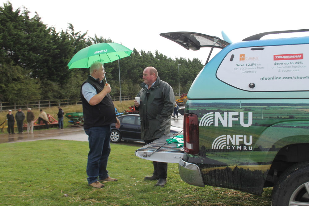 NFU Midlands business manager Nigel Pearson speaking with St Martins farmer Ted Jackson at the affinity roasdshow event at Halls Shrewsbury Livestock Market