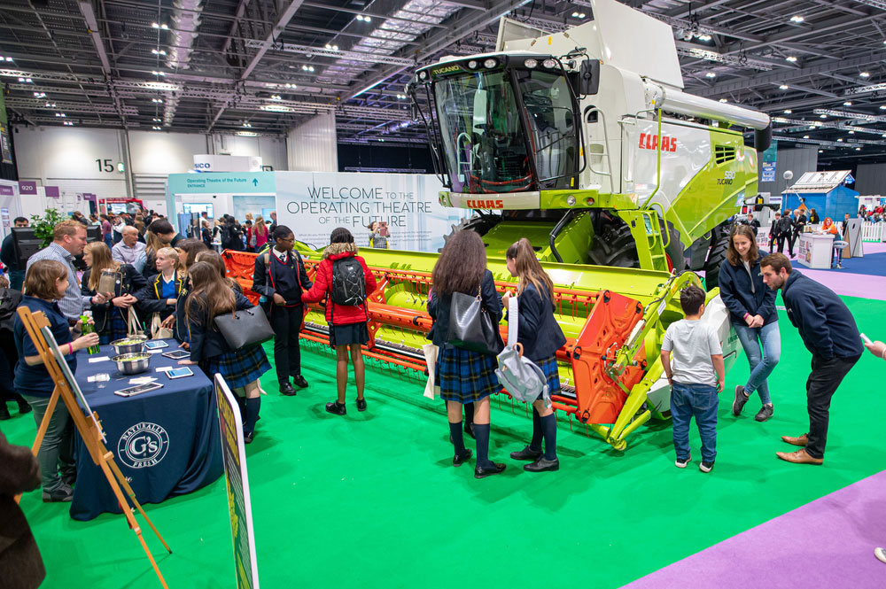 Anna Hunt and George Biss, NFU Student and Young Farmer Ambassadors, talking to school children at the Future of Farming, NS Live, Excel, 10th October 2019