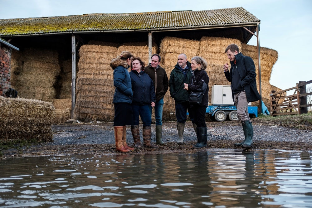 An image of NFU President Minette Batters and Environment Agency chair Emma Howard Boyd visiting NFU members Robert and Josie Robinson's farm at Fishlake, Doncaster, 20 November 2019