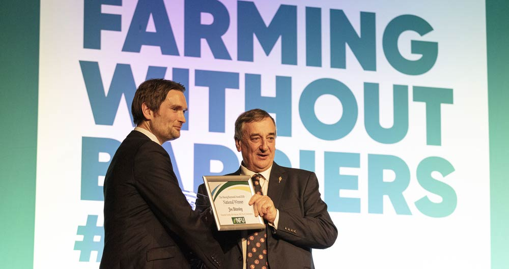 An image of Leicestershire farmer Joe Stanley receiving the Meurig Raymond Award at NFU Conference 2020