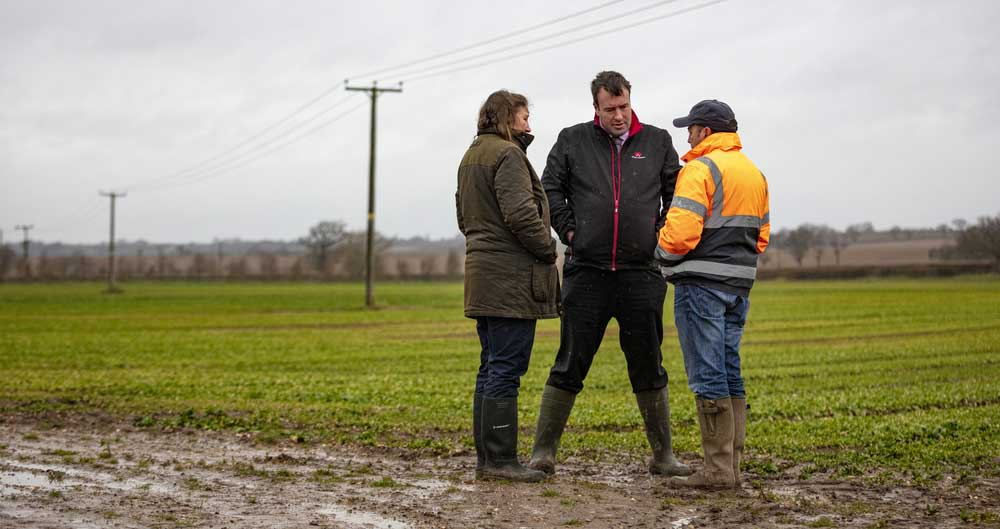 An image of NFU Deputy President Stuart Roberts visiting an NFU grower member in Warwickshire to see impacts of waterlogging on farm