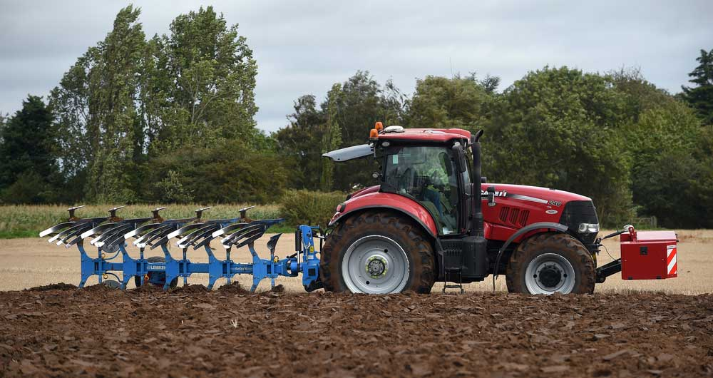 A tractor working in the fields on the Norfolk/Cambridgshire border