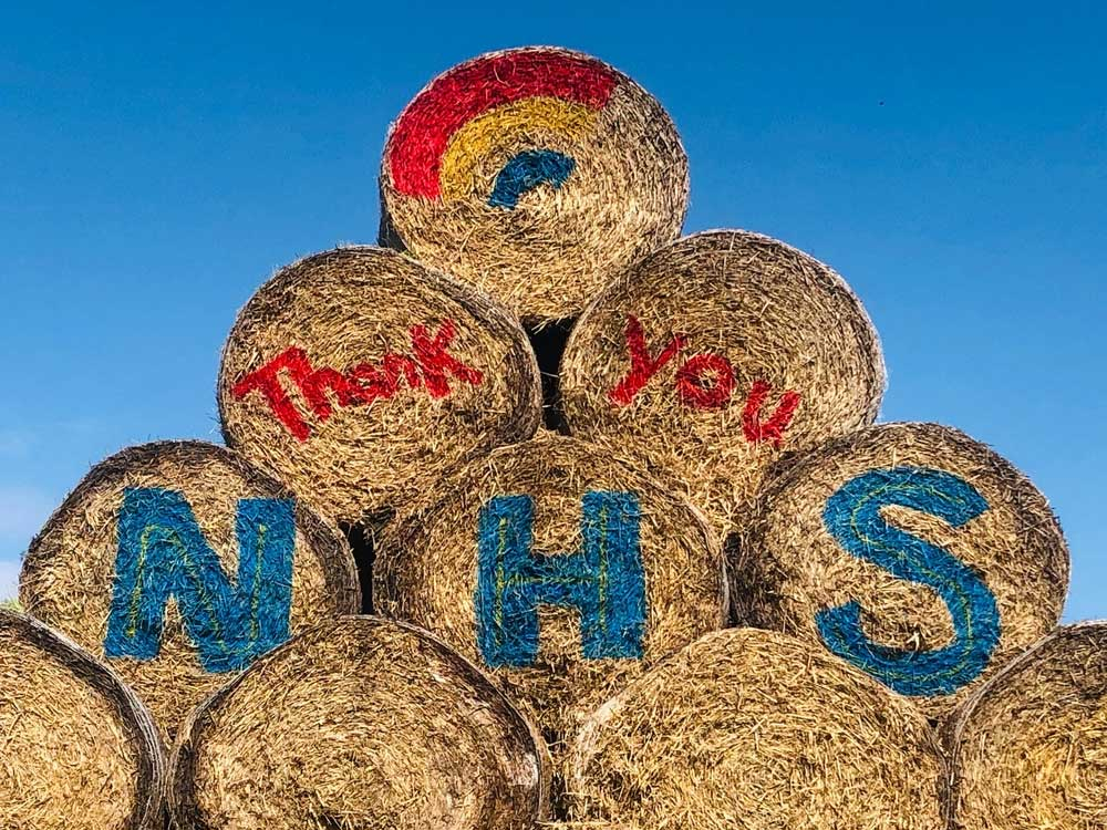 Big thank you to the NHS painted on to bales at Lower Drayton Farm by the Bower family