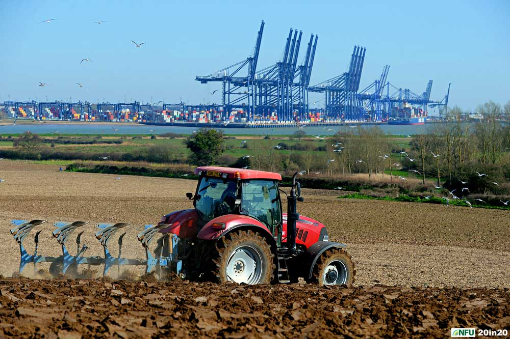 <h4>Ploughing at Shotley</h4><p>Farmer Andrew Packard ploughing land overlooking the Port of Felixstowe in March 2020. Photo: Nikon D4 + 80-200 F2.8 (105mm) 1/800 @ F8 ISO 160</p><p>Warren's comments: <em>I wanted a shot featuring the Port of Felixstowe and had scouted out the best view on GoogleEarth before heading down to Shotley. Once I'd found the right field, I went looking around farmyards for somebody to ask and luckily got landowner Andrew Packard first time around. Unfortunately, the chosen field was waterlogged for the next three months but my patience paid off in the end.</em></p>
