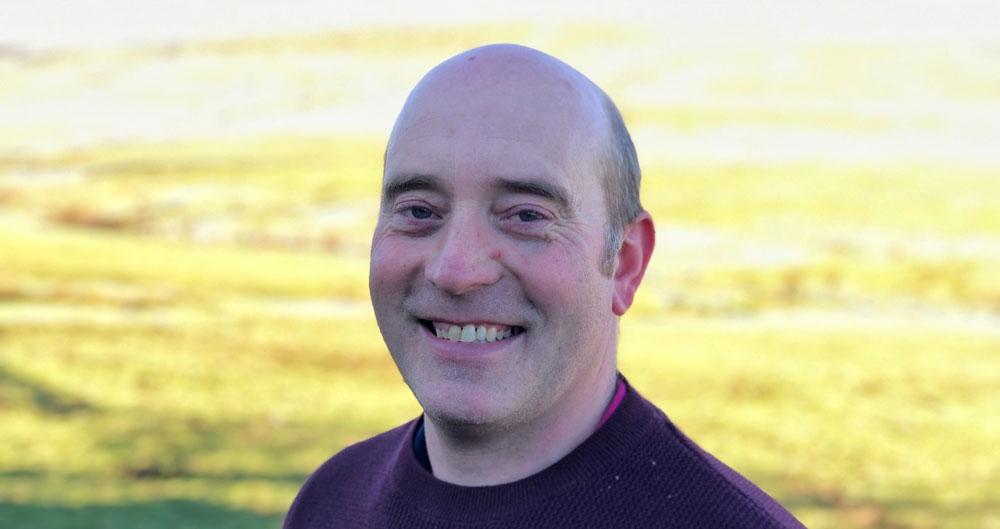 Greg Dalton standing on his farm.