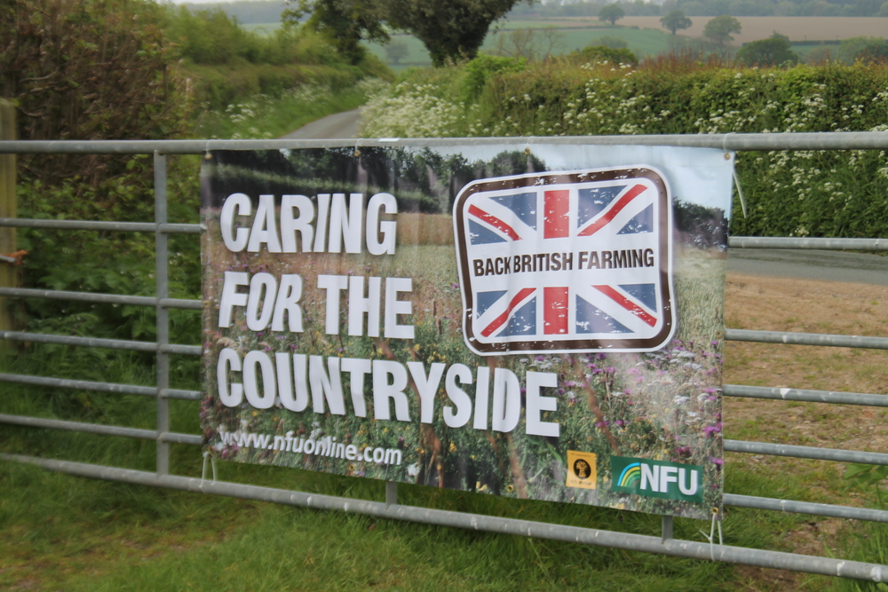 NFU care for the countryside banner at the Farm Nature Discovery Day, Onibury, 2019, at Rob Alderson's farm