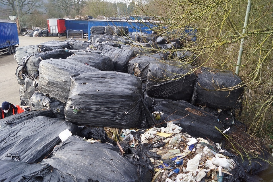 A pile of baled waste, bales splitting open to reveal contents