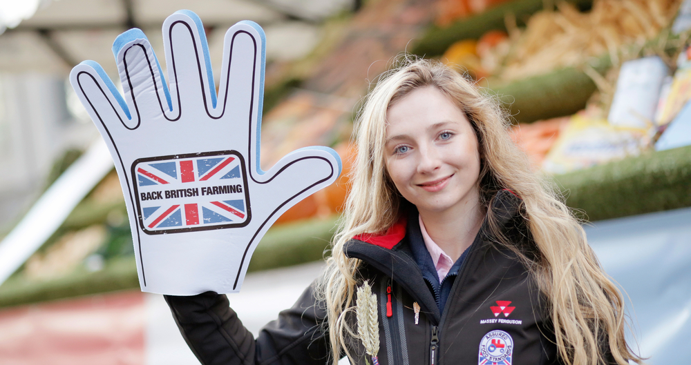 Sophie Thornton wearing a giant foam 'Back British Farming' hand at the 2019 Lord Mayor's Show
