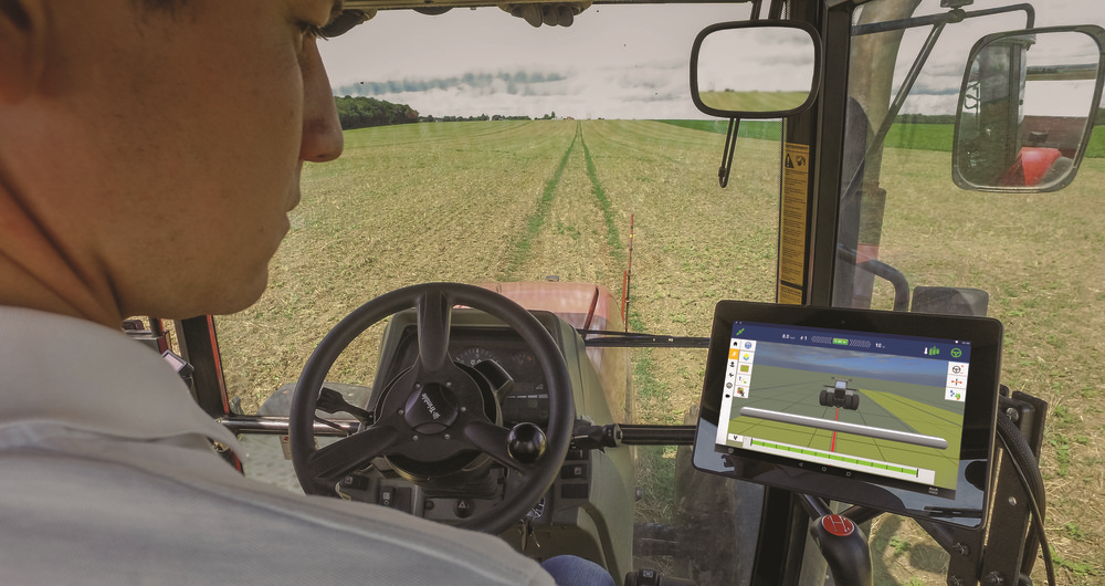 Man drives tractor with GPS in field