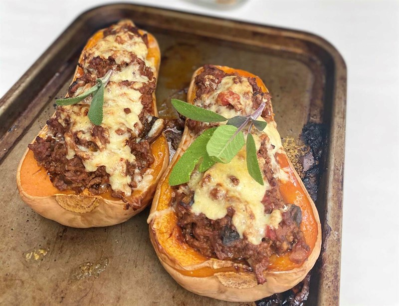 Baked butternut squash stuffed with beef and cheese